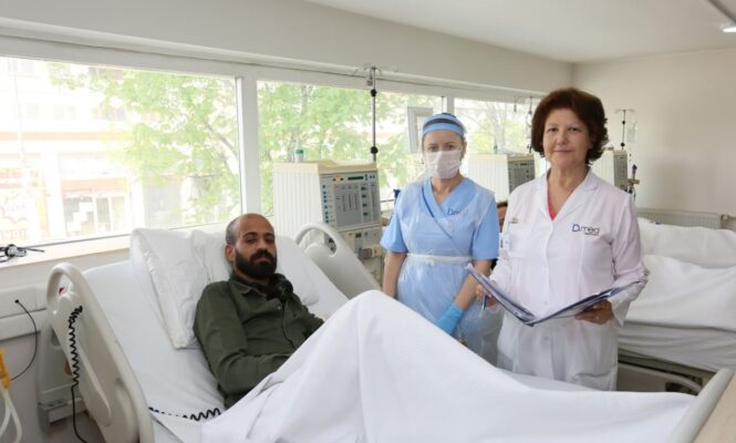 Doctor and Nurse caring for Dialysis patient