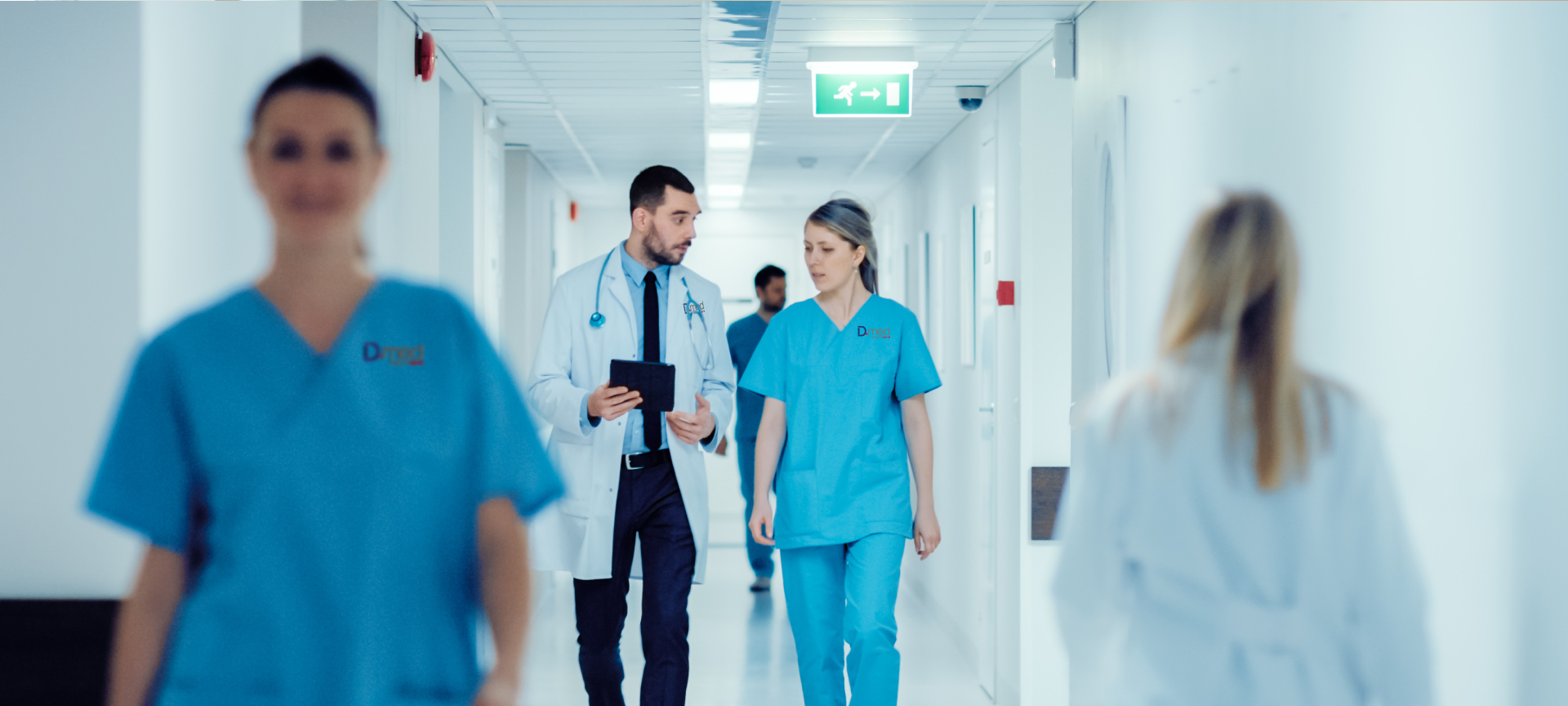 Healthcare staff walking down corridor